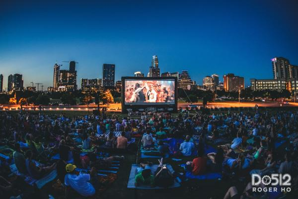 People gather on lawn to watch film for Sound and Cinema