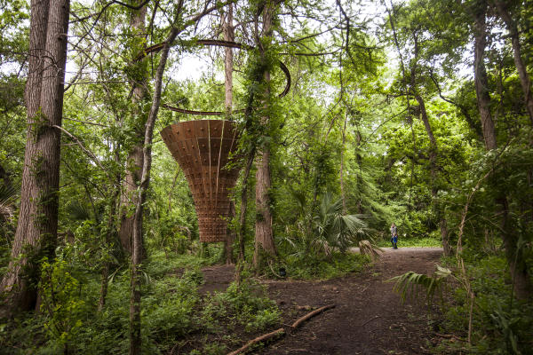 Canopy Tower sculpture by John Grade in forest at Laguna Gloria