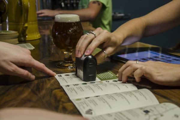 Stamping the Eugene Ale Trail Passport by Katie McGuigan
