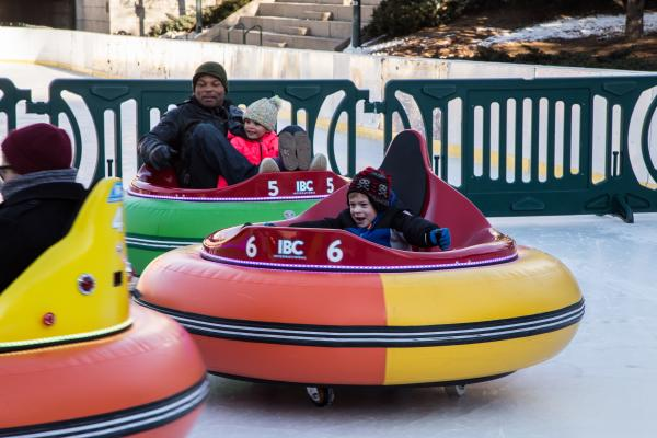 Kids playing in the Ice Bumper Cars at the Alex + Ani Center