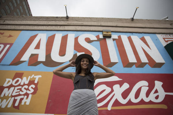 girl posing in front of Austin Texas mural