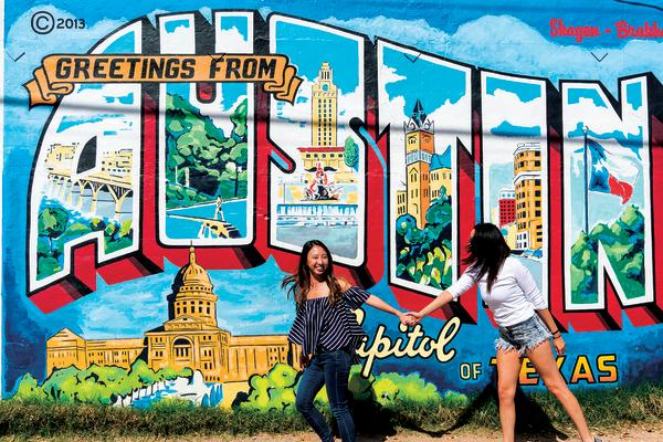 Around town south austin austin tx insider blog jane ko and friend posing at greetings from austin mural at roadhouse relics m4hsunfo