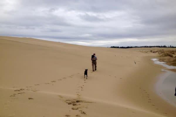Hiking with Dog Across the Oregon Dunes by Dina Pavlis
