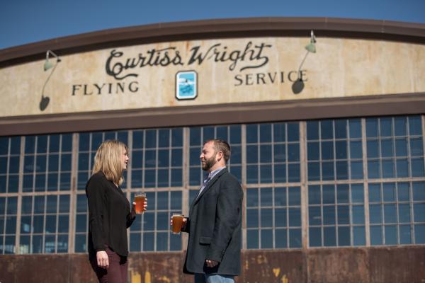 Couple at Hunter Gatherer Brewery at Curtiss-Wright Hangar