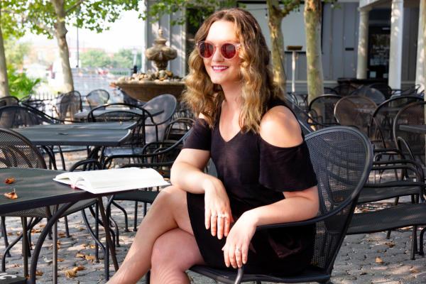 Ashley Hasty Sitting Outside at Roux Royale