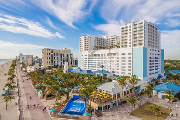 Beach facing exterior of Margaritaville Resort in Hollywood Beach FL