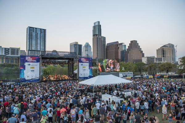 stage in the park for SXSW Music Festival in front of Austin city skyline