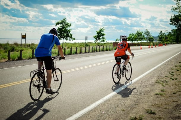 couple cycling on waterfront trail
