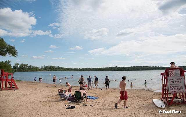 Beachgoers enjoy partly sunny day on one of Madison's lakes
