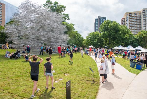 Crowd gathering at opening of Ai Weiweis Forever Bicycles at Waller Creek Delta