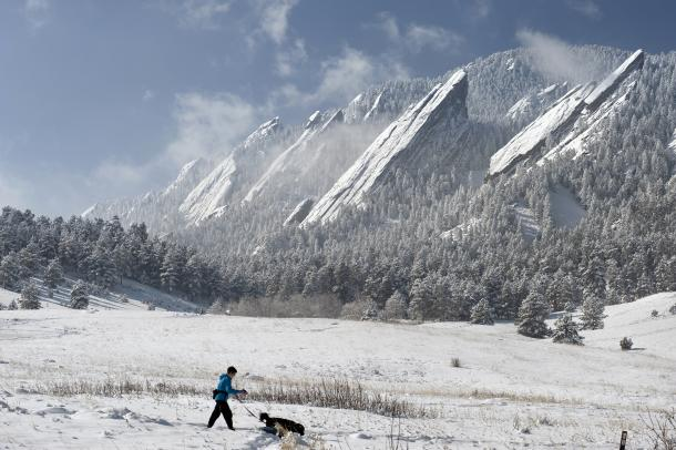 Person and Dog taking a winter hike at Flatirons
