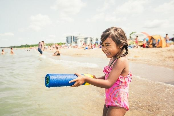 girl playing in water at Grand Bend beach