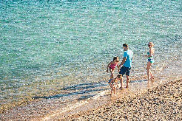 family on beach in canatara