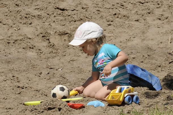 child playing in sand at mitchells bay