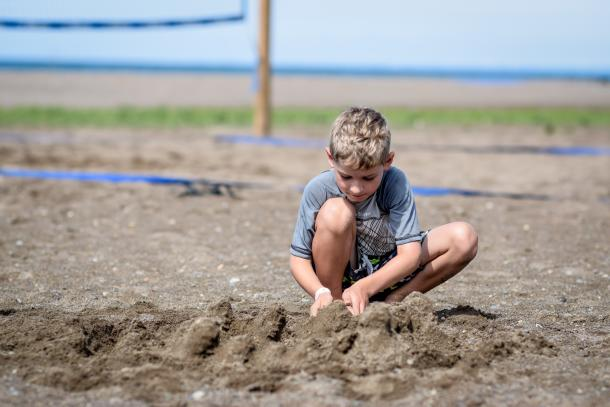 kid in sand at erieau