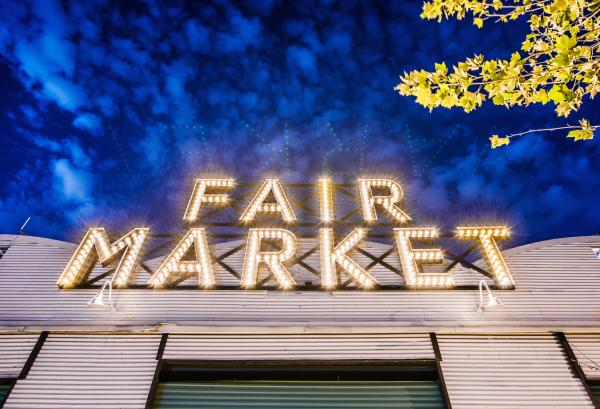 Fair Market exterior with lighted sign
