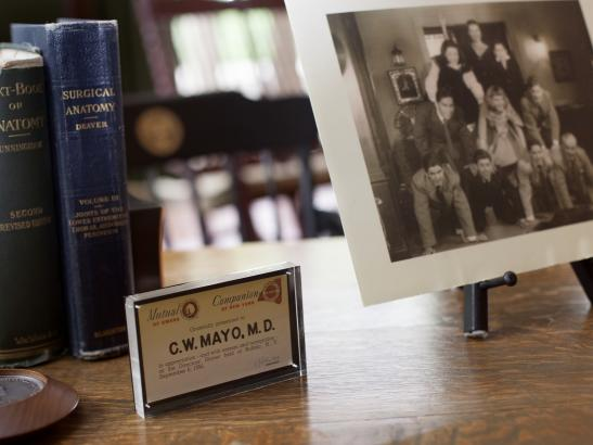 Family photos sit atop the desk of Dr. C.W. Mayo | credit olivejuicestudios.com