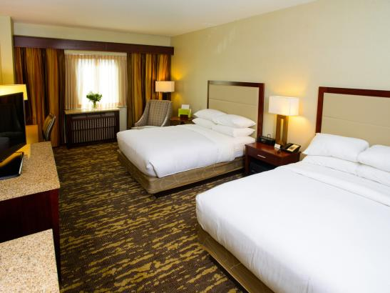 Standard guestrooms feature two double beds or one king size bed.