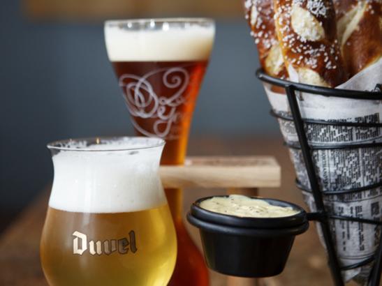 Hot pretzel sticks + Belgian beer | credit olivejuicestudios.com