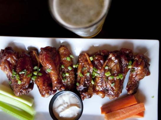 Chicken wings with choice of specialty sauces | credit olivejuicestudios.com