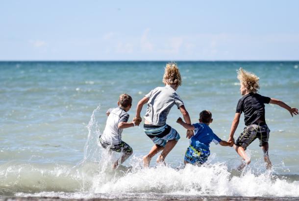 Kids jumping at erieau beach