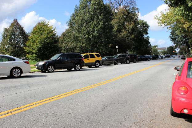 Cars parked along Carroll Parkway and College Avenue
