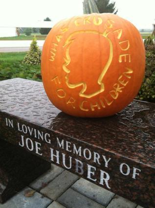 Joe Huber's bench and WHAS pumpkin