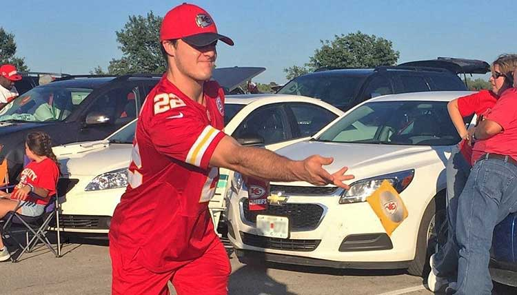 Playing cornhole while tailgating at a Chiefs game