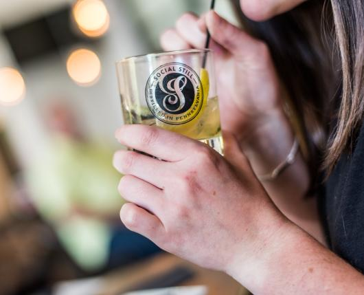 Social Still - Girl sipping cocktail