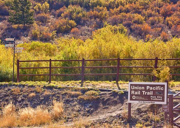 Union Pacific Rail Trail sign for bike rental trail in Park City, UT