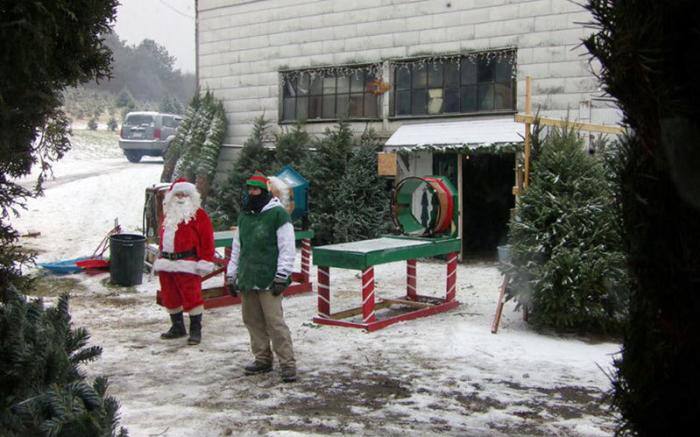 Santa and elf waiting for customers