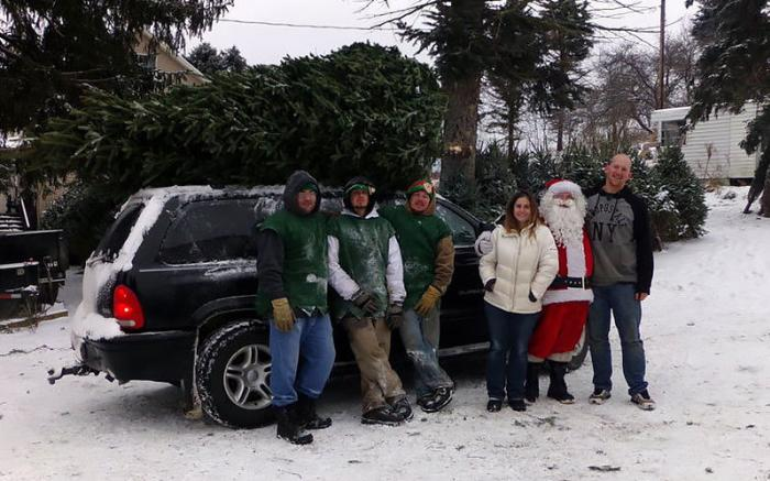 Large tree cut from the field,loaded by the elves and Santa