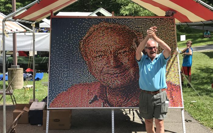 Artist Franz Spohn with Arnold Palmer Mural