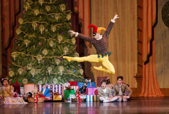 Dancer performing a leap in the Nutcracker by the Rochester City Ballet