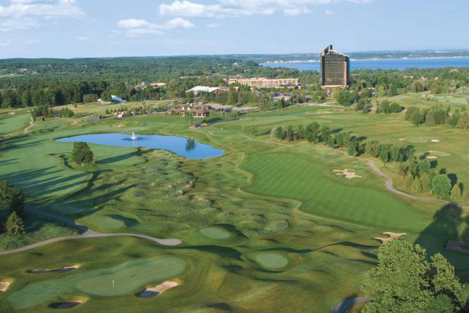 Aerial View of the Golf Courses With Tower