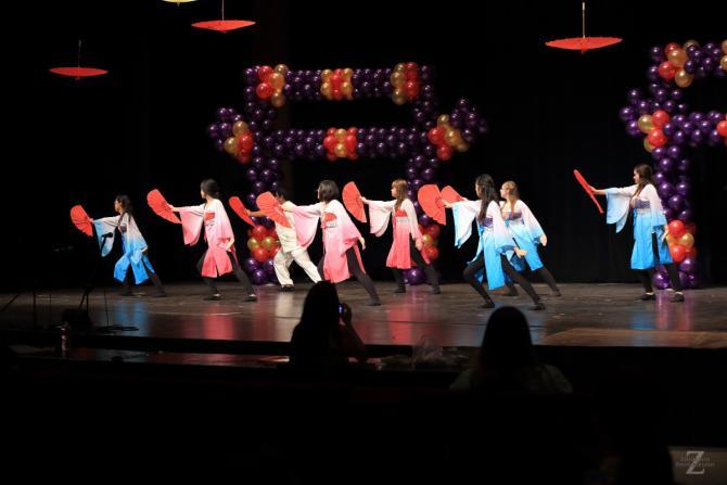 Participants at Wichita Asian Festival dance in Wichita KS