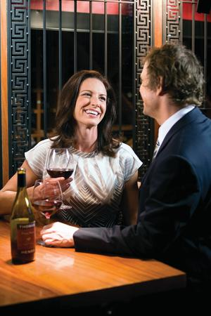 Byrd & Baldwin couple dining with wine
