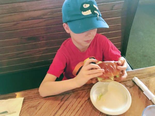Kid eating tenderloin