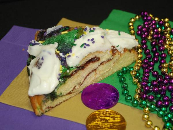 Traditional King Cake and beads at Zydeco's Cajun in Mooresville.