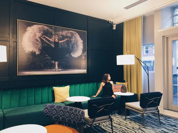 Woman looking out Hotel Trundle window