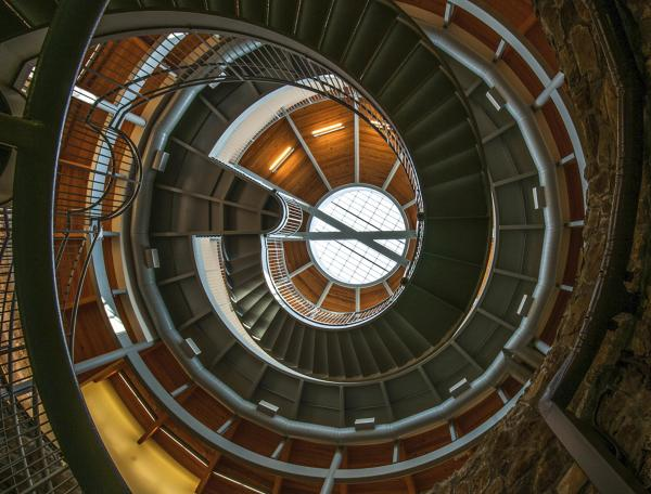 An upward photo of the winding stairs at the Big Well Museum