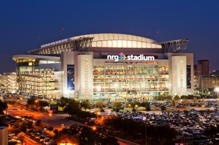 Night view of the NRG Stadium in Houston, Teax lit up for an event.