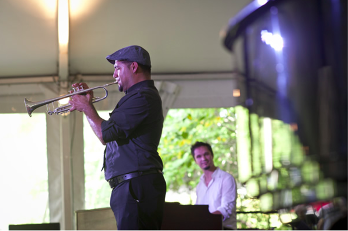 Man plays the trumpet with piano accompaniment at the Chicago Jazz Festival