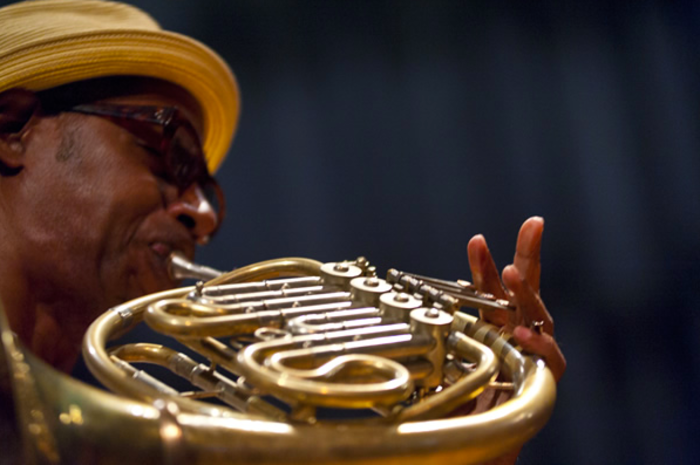 Man plays the french horn at the Chicago Jazz Festival