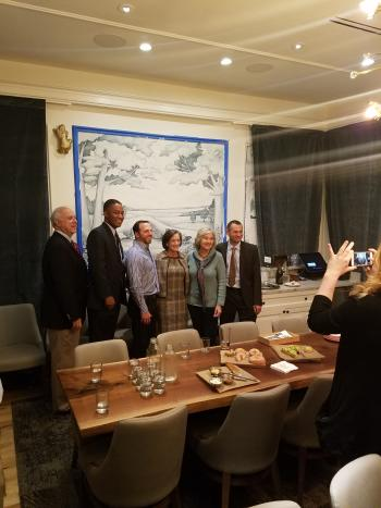Founding Farmers partners and local dignitaries gather in the Governor's Parlor, a private dining area.