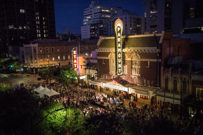 Paramount Theatre exterior at night with crowd