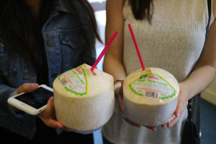 Women Holding Coconuts at OC Restaurant Week in Irvine