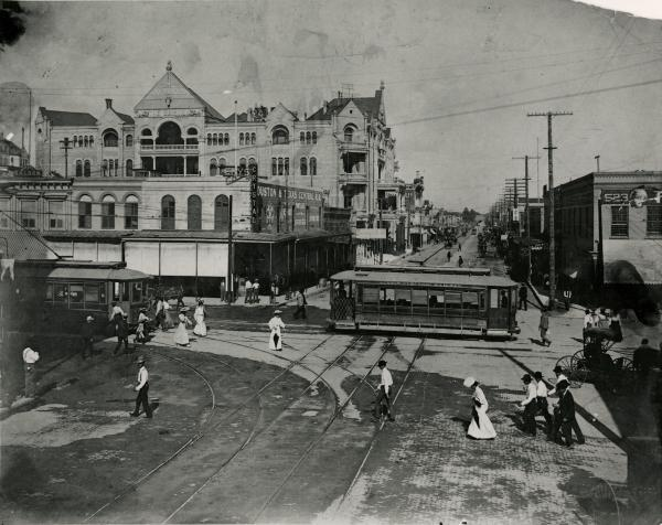 Street scene of historic Sixth Street and the Driskill Hotel around the turn of the century