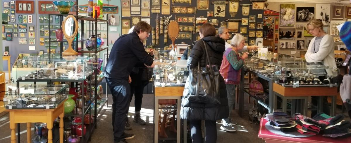 People shopping at the Boulder Arts & Crafts Gallery