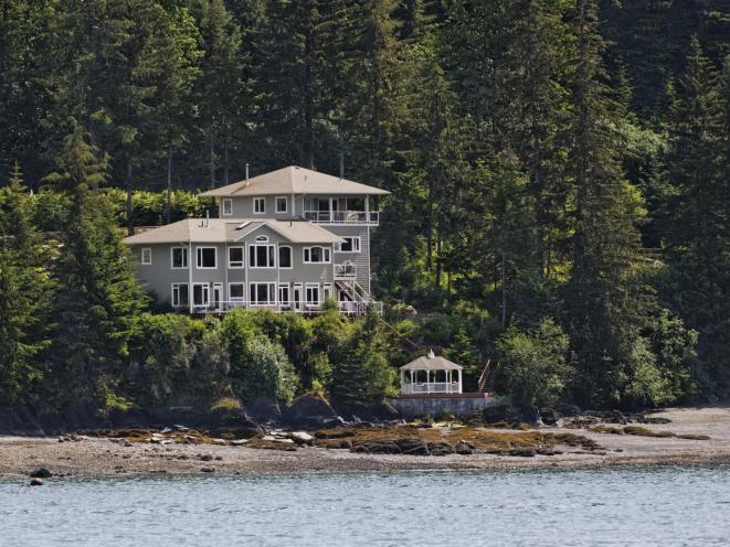 Our home, the AKNS Penthouse Suite, gazebo and beach from Auke Bay.